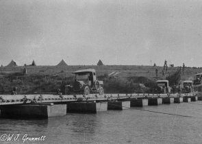 Ford trucks move supplies across a pontoon bridge, Persian Front, Mesopotamia, 1917/1918